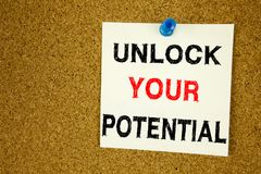A writing text showing concept of Unlock Your Potential made on sticky note handwritten letters words for Self-Development Improve. Ment concept white cork Royalty Free Stock Images