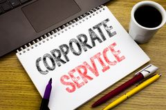 Writing text showing Corporate Service. Business concept for Csr Digital Content written on notebook book on the wooden background. Writing text showing Stock Images
