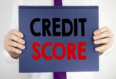Writing text showing Credit Score. Business concept for Financial Rating Record written on book notebook paper holding by the man. Writing text showing Credit stock photos