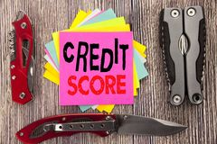 Writing text showing Credit Score. Business concept for Financial Rating Record Written on sticky note wooden background with pock. Writing text showing Credit stock image