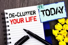 Writing text showing  De-Clutter Your Life. Business photo showcasing Free Less Chaos Fresh Clean Routine written on notebook book. Writing text showing  De Royalty Free Stock Images