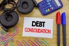 Writing text showing Debt Consolidation. Business concept for Money Loan Credit written on sticky note paper on the wooden backgro. Writing text showing Debt Royalty Free Stock Images