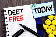 Writing text showing Debt Free. Business photo showcasing Credit Money Financial Sign Freedom From Loan Mortage written on notebo. Writing text showing Debt Free royalty free stock photo