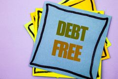 Writing text showing  Debt Free. Business photo showcasing Credit Money Financial Sign Freedom From Loan Mortage written on sticky. Writing text showing  Debt Royalty Free Stock Image