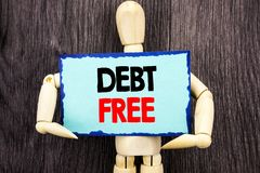 Writing text showing Debt Free. Concept meaning Credit Money Financial Sign Freedom From Loan Mortage written on Sticky Note Hold royalty free stock photography