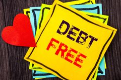 Writing text showing  Debt Free. Concept meaning Credit Money Financial Sign Freedom From Loan Mortage written on Stikcy Note Pape. Writing text showing  Debt Royalty Free Stock Photo