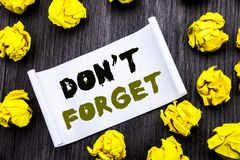 Writing text showing Do Not Forget. Business concept for Don t memory Remider Written on sticky note notepad note notebook book wo. Writing text showing Do Not Stock Photo