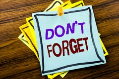 Writing text showing Do Not Forget. Business concept for Don t memory Remider written on sticky note paper on the wooden backgroun. Writing text showing Do Not Stock Image
