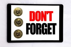 Writing text showing Do Not Forget. Business concept for Don t memory Remider written on tablet screen on the white background wit. Writing text showing Do Not stock image