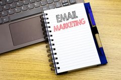 Writing text showing Email Marketing. Business concept for Online Web Promotion written on notebook book on the wooden background. Writing text showing Email Royalty Free Stock Photo