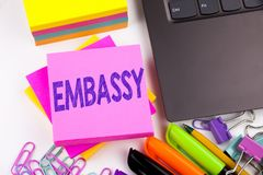 Writing text showing Embassy made in the office with surroundings such as laptop, marker, pen. Business concept for Tourist Visa A. Pplication Workshop white Stock Photo