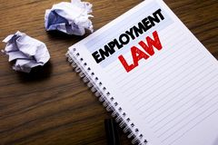 Writing text showing Employment Law. Business concept for Employee Legal Justice written on notebook notepad note paper on the woo. Writing text showing Stock Image