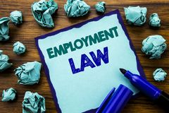Writing text showing Employment Law. Business concept for Employee Legal Justice Written on sticky note paper, wooden background w. Writing text showing Stock Photos