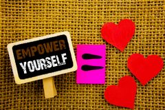 Writing text showing  Empower Yourself. Concept meaning Positive Motivation Advice For Personal Development written on blackboard. Writing text showing  Empower Royalty Free Stock Image