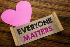Writing text showing Everyone Matters. Business concept for Equality Respect written on sticky note paper, wooden wood background. Writing text showing Everyone stock image