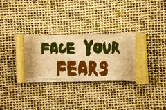 Writing text showing Face Your Fears. Business photo showcasing Challenge Fear Fourage Confidence Brave Bravery written on Tear S. Writing text showing Face Your royalty free stock images