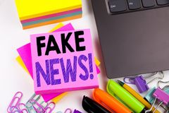 Writing text showing Fake News made in the office with surroundings such as laptop, marker, pen. Business concept for Propaganda N. Ewspaper Fake News Workshop Royalty Free Stock Image