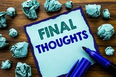 Writing text showing Final Thoughts. Business concept for Conclusion Summary Text Written on sticky note paper, wooden background. Marker folded yellow paper Royalty Free Stock Photos