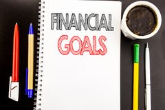 Writing text showing Financial Goals. Business concept for Income Money Plan Written on notepad note paper background with space o. Writing text showing Stock Image