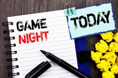 Writing text showing Game Night. Business photo showcasing Entertainment Fun Play Time Event For Gaming written on notebook book. Writing text showing Game Night royalty free stock images