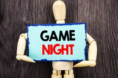 Writing text showing Game Night. Concept meaning Entertainment Fun Play Time Event For Gaming written on Sticky Note Holding By S. Writing text showing Game royalty free stock photos