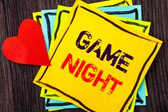 Writing text showing Game Night. Concept meaning Entertainment Fun Play Time Event For Gaming written on Stikcy Note Paper on the. Writing text showing Game royalty free stock photos