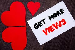 Writing text showing  Get More Views. Concept meaning More Traffic Leads Online Page Promotion Popularity Traffic written on notob. Ook paper note on  wooden Stock Images