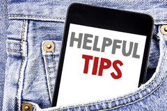 Writing text showing Helpful Tips. Business concept for Help in FAQ or Advice, written on cellphone phone smartphone in the men po. Writing text showing Helpful Royalty Free Stock Photography
