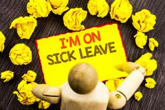 Writing text showing  I m am On Sick Leave. Business photo showcasing Vacation Holiday Absent Out Of Office Sickness Fever written. Sticky Note Holding By Stock Photography