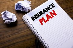 Writing text showing Insurance Plan. Business concept for Health Life Insured written on notebook notepad note paper on the wooden. Writing text showing Stock Photo