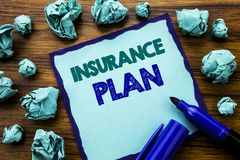 Writing text showing Insurance Plan. Business concept for Health Life Insured Written on sticky note paper, wooden background with. Writing text showing Royalty Free Stock Photography