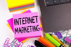 Writing text showing Internet Marketing made in the office with surroundings such as laptop, marker, pen. Business concept for Tec Royalty Free Stock Images