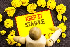 Writing text showing  Keep It Simple. Business photo showcasing Simplicity Easy Strategy Approach Principle written on Sticky Note. Writing text showing  Keep It Stock Photos