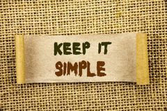 Writing text showing  Keep It Simple. Business photo showcasing Simplicity Easy Strategy Approach Principle written on Tear Sticky. Writing text showing  Keep It Stock Photography