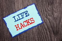 Writing text showing  Life Hacks. Business photo showcasing Solution Hacking Hack Trick To Help Efficiency written on Blue Sticky. Writing text showing  Life Royalty Free Stock Image