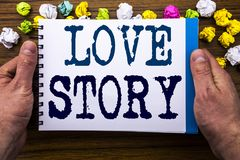 Writing text showing Love Story. Business concept for Loving Someone Heart  written on notepad notebook book on the wooden wood ba. Writing text showing Love Royalty Free Stock Photo
