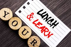 Writing text showing Lunch And Learn. Business photo showcasing Presentation Training Board Course written on tear note paper sti stock image