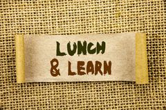 Writing text showing  Lunch And Learn. Business photo showcasing Presentation Training Board Course written on Tear Sticky Note Pa Stock Photo
