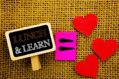 Writing text showing  Lunch And Learn. Concept meaning Presentation Training Board Course written on blackboard equation Meaning L. Writing text showing  Lunch Stock Photo
