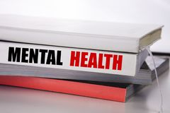Writing text showing Mental Health. Business concept for Anxiety Illness Disorder written on the book on the white background. Writing text showing Mental stock photography