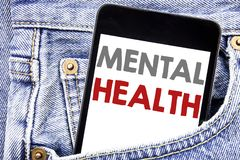 Writing text showing Mental Health. Business concept for Anxiety Illness Disorder written on cellphone phone smartphone in the men. Writing text showing Mental stock images