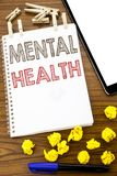 Writing text showing Mental Health. Business concept for Anxiety Illness Disorder written on note paper with folded Meaning Thinki. Writing text showing Mental stock photos
