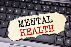Writing text showing Mental Health. Business concept for Anxiety Illness Disorder written on sticky note paper on the black keyboa. Writing text showing Mental royalty free stock photography