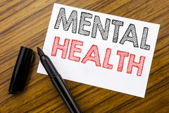 Writing text showing Mental Health. Business concept for Anxiety Illness Disorder written on sticky note paper on the wooden backg. Writing text showing Mental royalty free stock photos