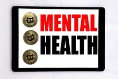 Writing text showing Mental Health. Business concept for Anxiety Illness Disorder written on tablet screen on the white background. Writing text showing Mental royalty free stock photo