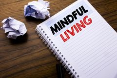 Writing text showing Mindful Living. Business concept for Life Happy Awareness written on notebook notepad note paper on the woode. Writing text showing Mindful Royalty Free Stock Photography