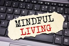 Writing text showing Mindful Living. Business concept for Life Happy Awareness written on sticky note paper on the black keyboard. Writing text showing Mindful Royalty Free Stock Images