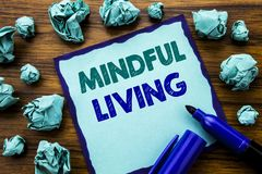Writing text showing Mindful Living. Business concept for Life Happy Awareness Written on sticky note paper, wooden background wit. Writing text showing Mindful Stock Photos