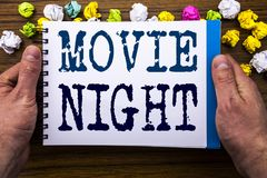 Writing text showing Movie Night. Business concept for Wathing Movies written on notepad notebook book on the wooden wood backgro. Writing text showing Movie royalty free stock photography