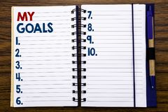 Writing text showing My Goals. Business concept for List Plan for Motivation Written on notebook note paper, wooden background wit royalty free stock photos